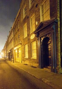 Old houses on Fournier Street seen at night.