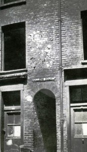 A photograph showing the arched entrance into Miller's Court.