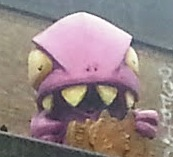 A pink monster looking down from a ledge that we pass on our Jack the Ripper Walk.