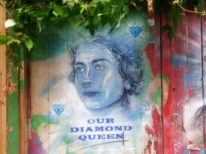 A portrait of the Queen on a wall in Spitalfields.