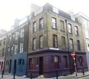 A house that stands on the junction of Wilkes Street and Princelet Street.