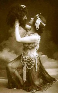Dancer Maude Allan as Salome holding the head of John the Baptist.