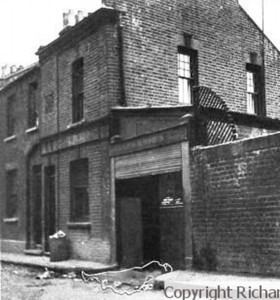 A black and white image showing the site of the murder of Mary Nichols.