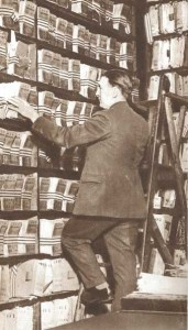 A detective on a ladder at the New  Scotland Yard Fingerprinting Bureau.