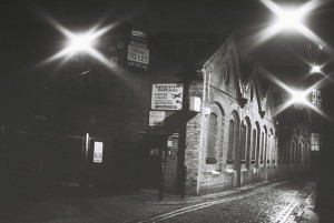 A black and white image showing Gunthorpe Street by night.
