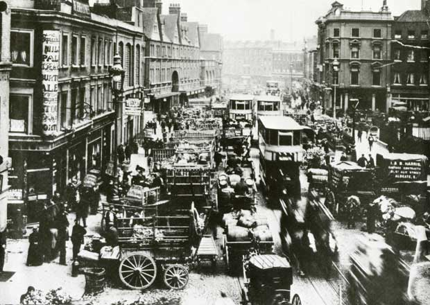 An image of Commercial Street filled with horse drawn carts and carriages.