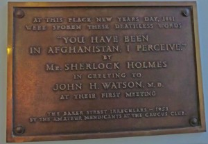 The plaque on the wall at St Barts Hospital showing where Sherlock Holmes met with Watson.