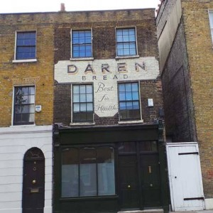 """A sign for Daren Bread extolling it as """"Best For Health."""""""