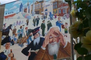 A mural showingfamous figures from the past in the East End of London.