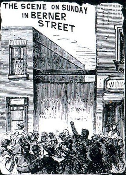 Crowds gather outside the entrance to Dutfield's Yard where Elizabeth Stride was murdered.