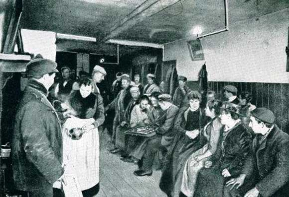 A photo showing the interior of a common lodging house kitchen.