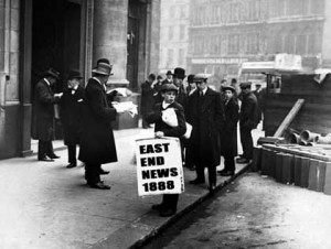 A newspaper boy holds a placard with News For 1888 on it.