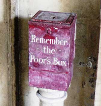 The red box with Remember the Poor's box written on it.