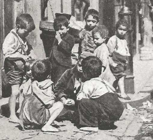 A group of children on the East End streets.