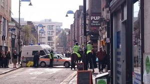 A film shoot with police horse and cars at work on Toynbee Street.
