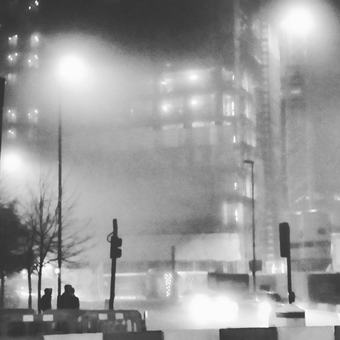 An image of a Whitechapel Street in the fog.