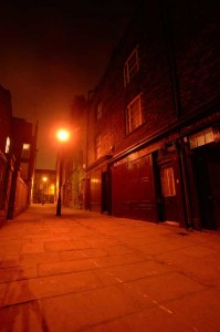 A view along Puma Court in Whitechapel by night.