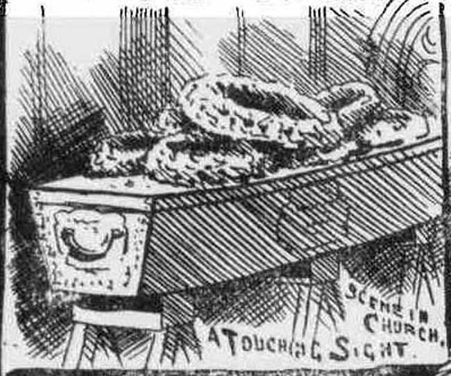 An image of a wooden coffin with wreaths on top of it.