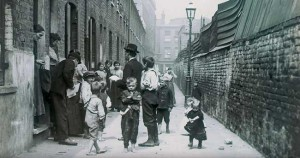 Missionaries visiting the residents of a London slum in the 19th century.