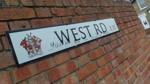 The sign saying West Road.