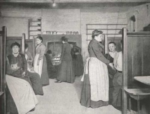 Women sit at tables in a Common Lodging House Kitchen
