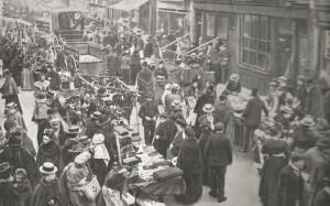 People shopping and walking along Brick Lane.