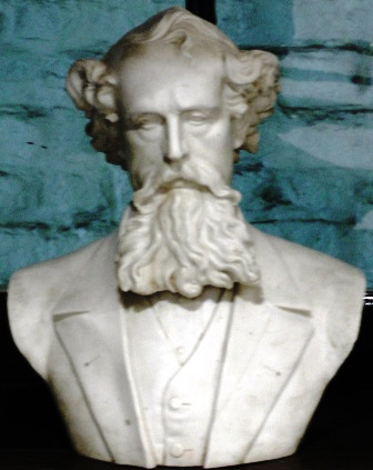 A white marble bust of Charles Dickens.