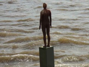 The figure in the Thames outside the Grapes Pub.