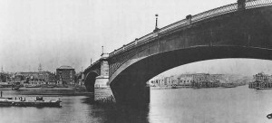 A view of the stone arches of Southwark Bridge.