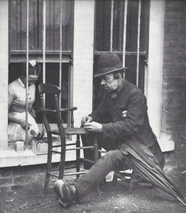 A photograph showing Caney the Clown repairing a chair.
