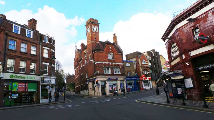 A view of the former Fire Station with a clock tower and clock visible above it.
