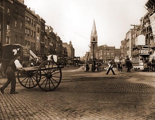 A view of St Mary's Church seen along Whitechapel High Street.