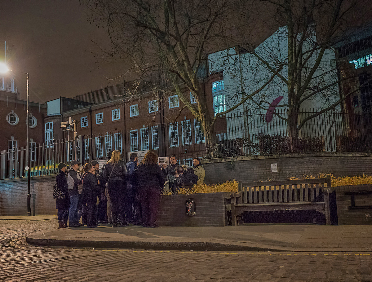 The jack the Ripper tour group gathered in Mitre Square scene of the murder of Catherine Eddowes.