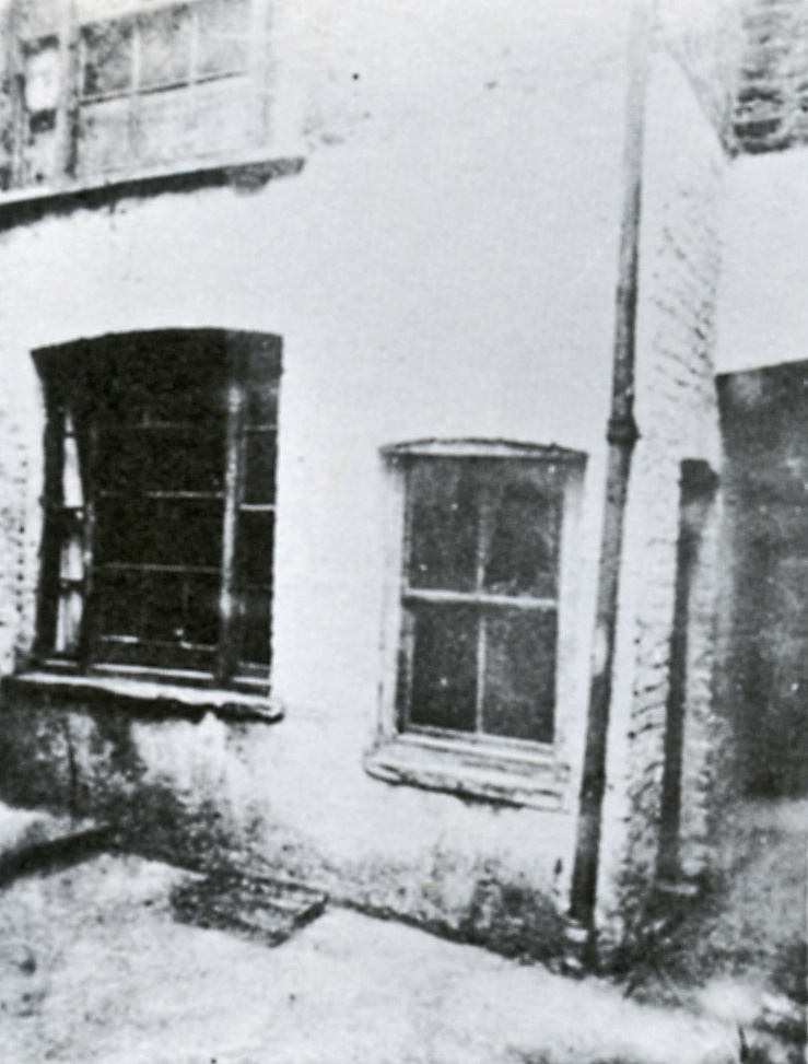 The photograph showing the windows of Mary Kelly's Room from the outside.