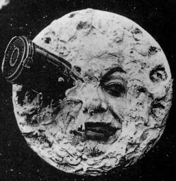 The image of the moon with a space craft embedded in its eye.