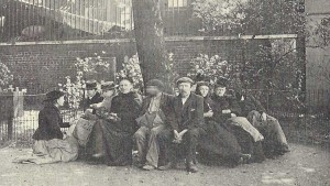 A group of people relazing on an East End bench.
