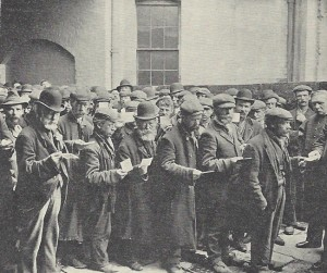 A group of homeless men gather in the Salvation Army yard.