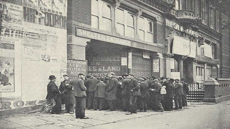 A group of men gather outside the Whitechapel Salvation Army Shelter.