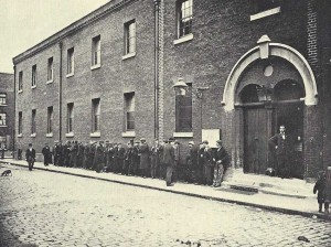 A group gather outside the Workhouse.