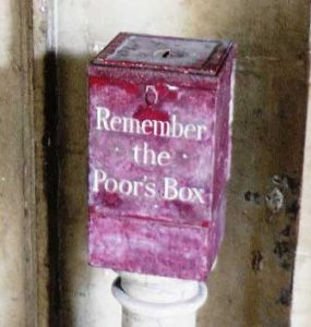 The red box with Remember The Poor's Box written in white lettering on its front.