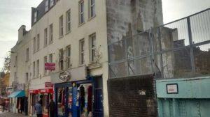 A view of the cream exteriors of 5 to 7 Thomas Street, Whitechapel.