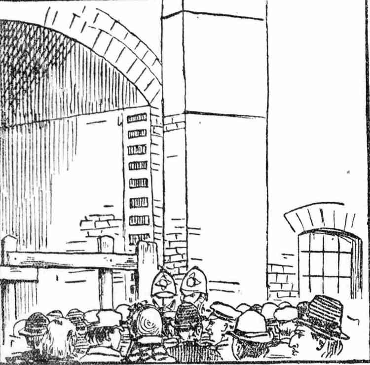 A crowd gathers around the Pinchin Street Arch.