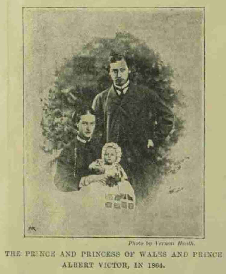 The Pirnce and Princess of Wales holding the infant Prince Albert Victor.