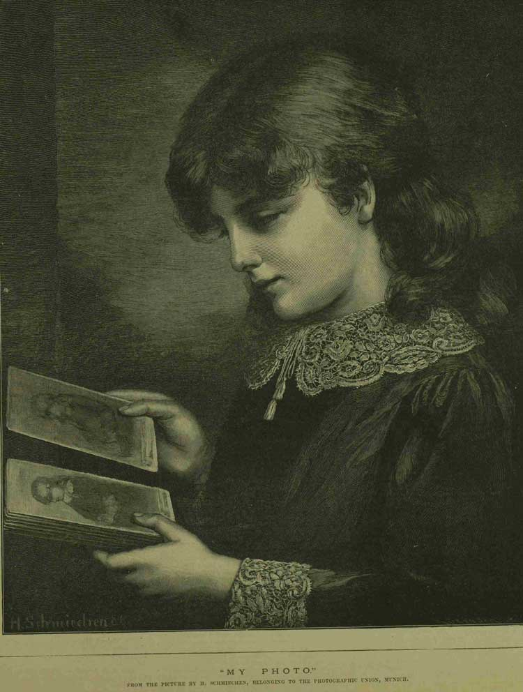 A reproduction of a photo of a girl looking at a photo album.