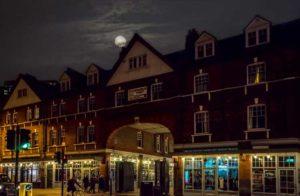 A view of Spitalfields Market by night.