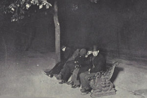A group of men on a bench on the Embankment.