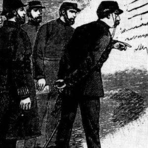 Warren inspects the Goulston Street Graffito.