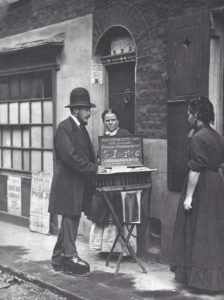 A photograph showing a street doctor with two women.