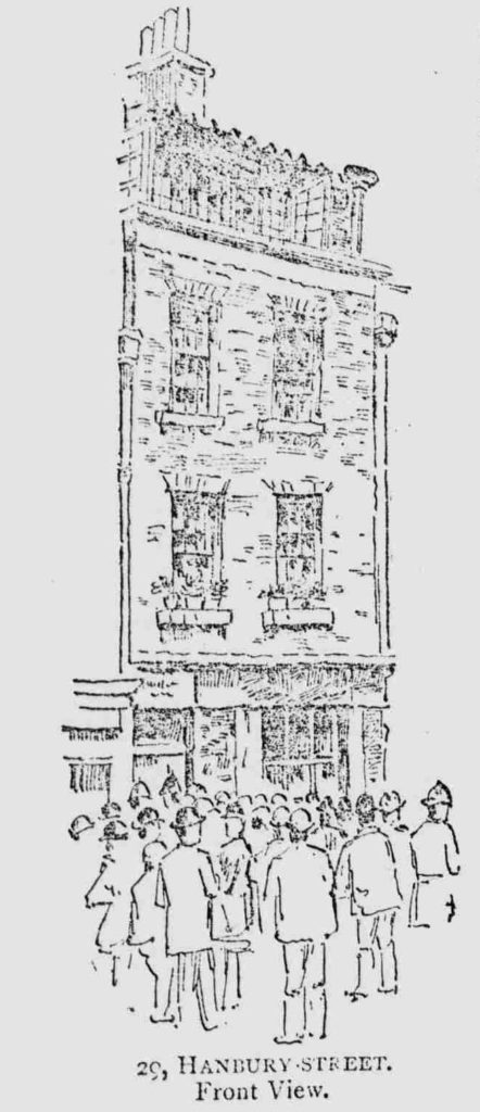 An illustration showing crowds in the street outside the front of 29 Hanbury Street.