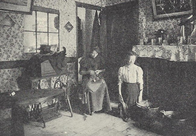 Two women inside a room.